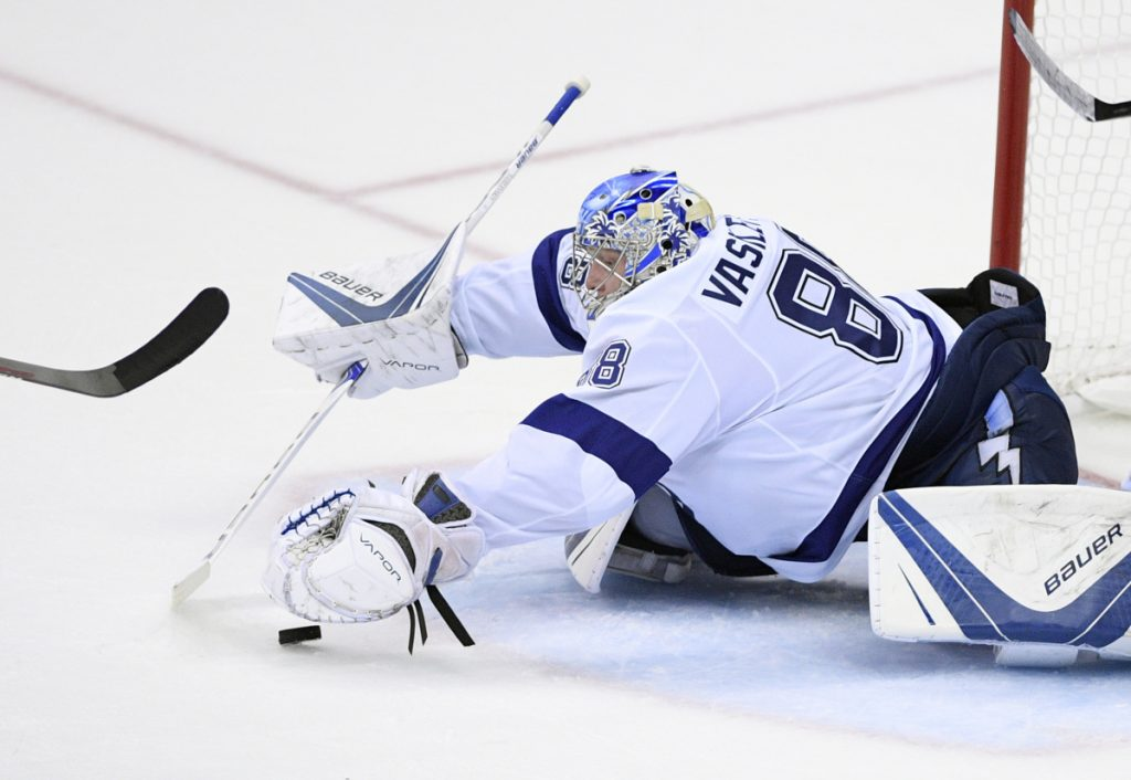 Tampa Bay goaltender Andrei Vasilevskiy reaches for the puck during the third period of Tuesday's game in Washington. Vasilevskiy made 36 saves as the Lightning beat the Capitals 4-2 and trail the Eastern Conference finals 2-1.