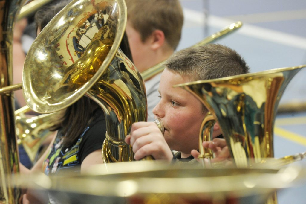 Young musicians rehearse at the Riverton school in Portland during the District 2 Elementary Music Festival in 2010. A letter writer warns that cutting the school budget threatens music programs.