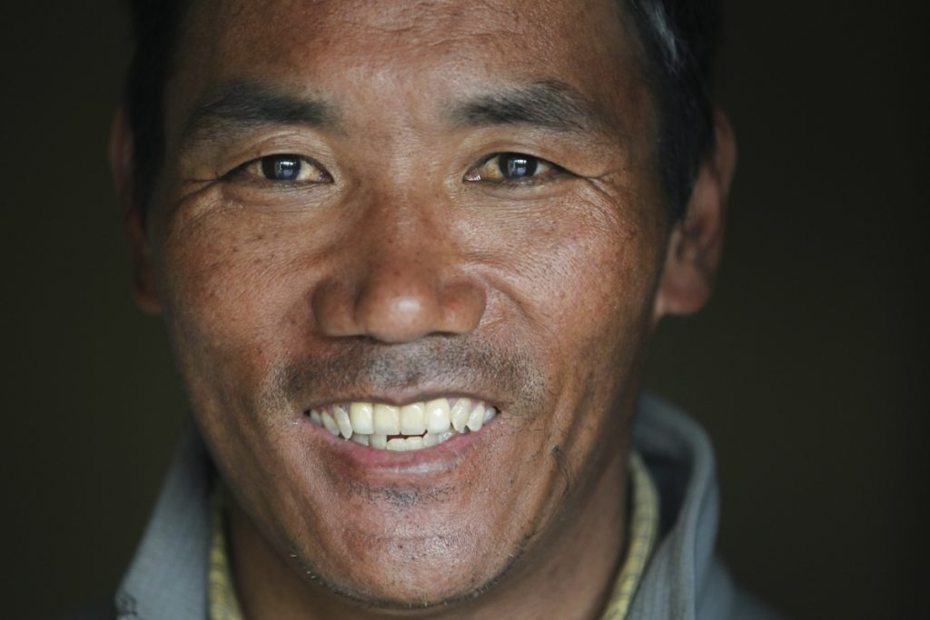 Nepalese veteran Sherpa guide Kami Rita, 48, scaled Mount Everest on Wednesday for the 22nd time, setting the record for most climbs of the world's highest mountain, officials said.