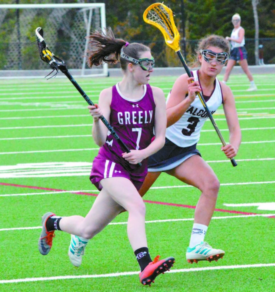 Greta Van Curan of Greely carries the ball down the field while being pursued by Freeport's Allison Greuel during Greely's 13-10 lacrosse victory Wednesday.