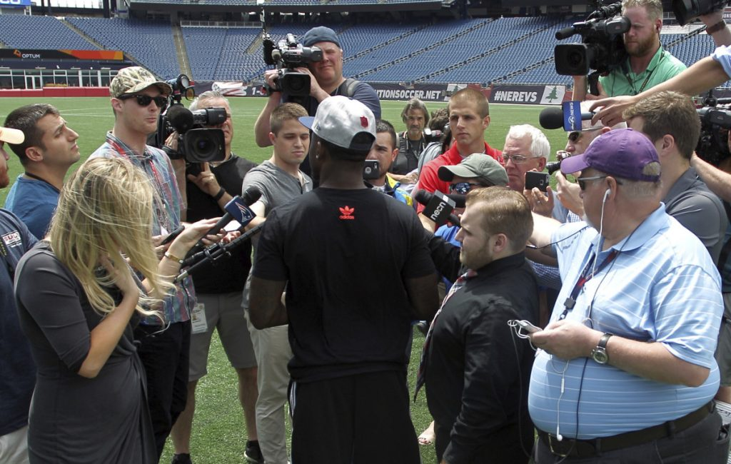 Members of the media surround Duke Dawson, the second round pick of the New England Patriots, on Tuesday at Gillette Stadium in Foxborough, Mass. He signed with the team on Wednesday.