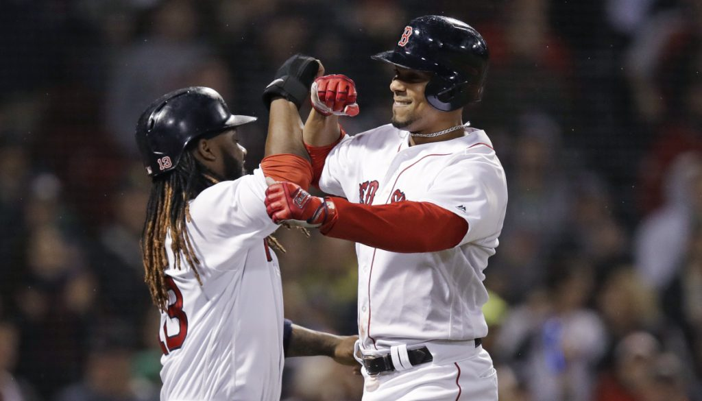 Boston's Xander Bogaerts, right, is congratulated by Hanley Ramirez after hitting a three-run home run in the sixth inning Wednesday night at Fenway Park.