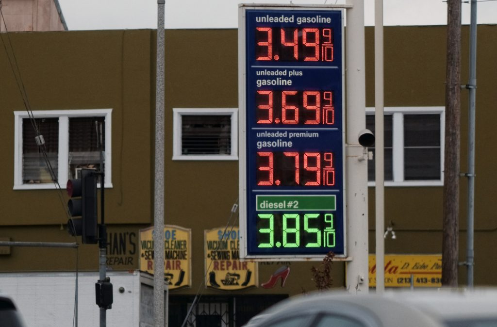 Gasoline prices are displayed at a gas station near downtown Los Angeles on Friday. Their recent rise stems from Trump's handling of the Iran nuclear deal, a reader writes.