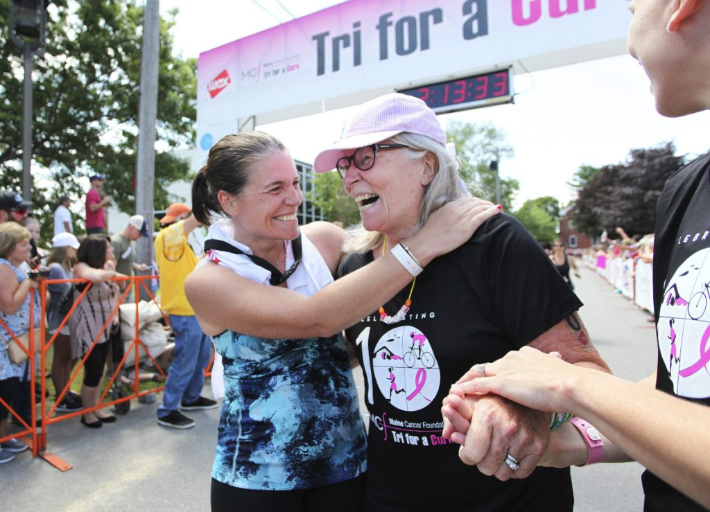 Julie Degenhardt celebrates with her mother, cancer survivor Joanne Longacre, after last year's Tri for a Cure. The event is one of three in Maine that sell out in a day.