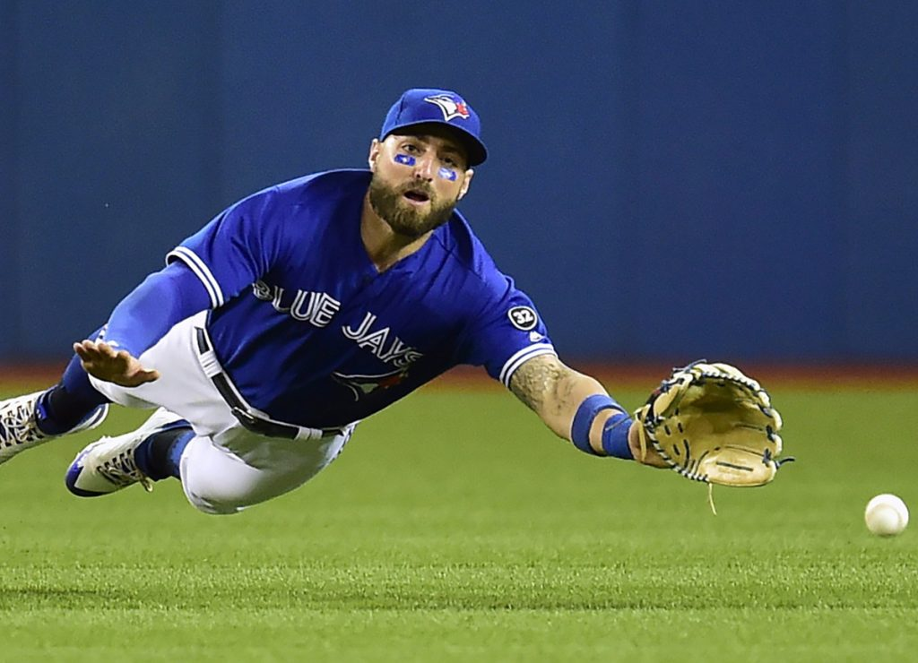 Toronto's fielder Kevin Pillar can't make it to a fly ball hit for a double by Oakland's Jed Lowrie in Friday's game at Toronto. Oakland won 3-1.