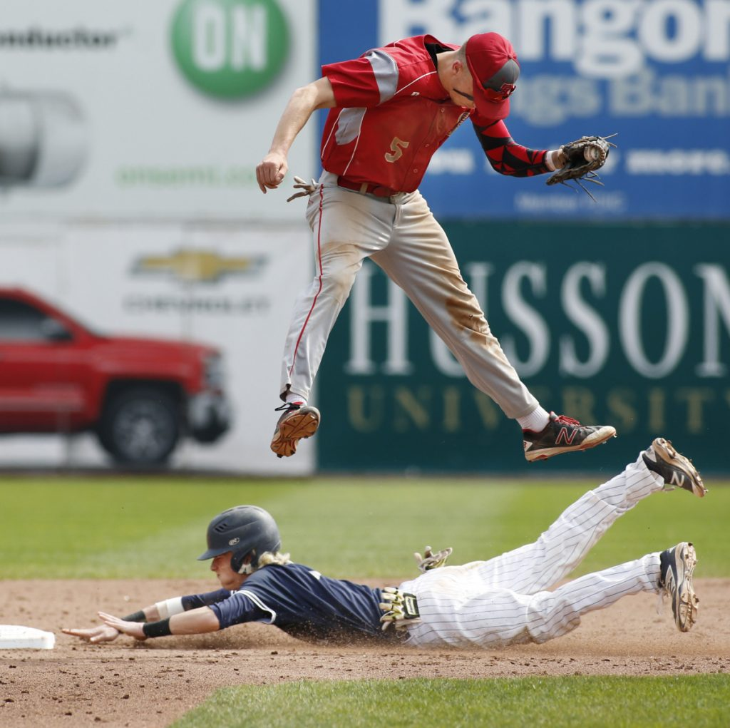 Camren King of Portland steals second base in the fourth inning Saturday as Riley Hasson of South Portland leaps for the throw. South Portland was held hitless until the fifth inning but scored four runs in the final two innings to ralliy for a 4-1 victory – its seventh in a row.