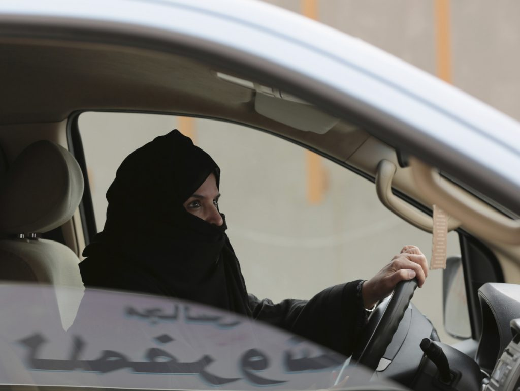 Aziza al-Yousef drives a car in Riyadh in 2014 as part of a campaign to defy Saudi Arabia's ban on women driving.