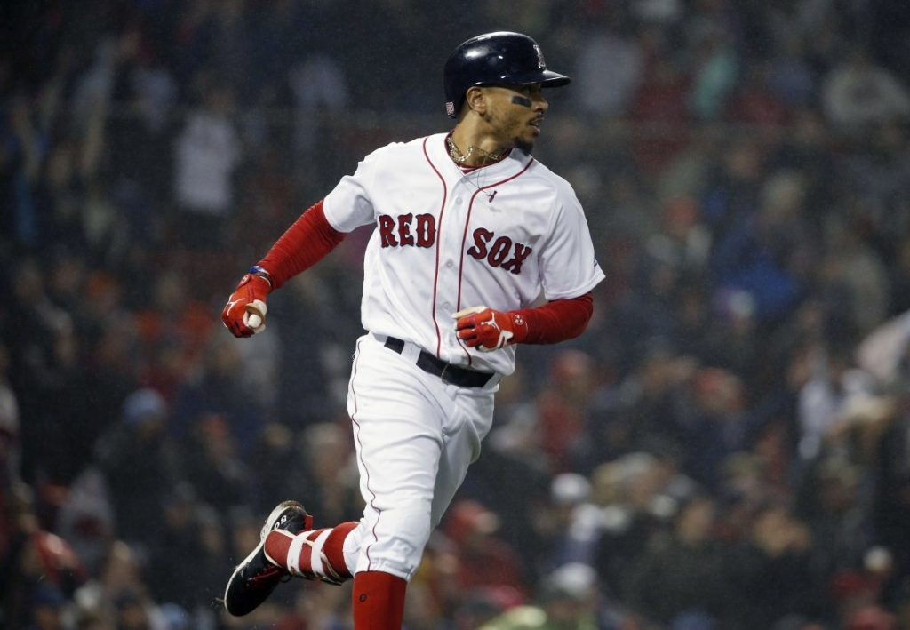 Mookie Betts watches his two-run home run during the fifth inning of Boston's win over the Baltimore Orioles in Boston on Saturday.