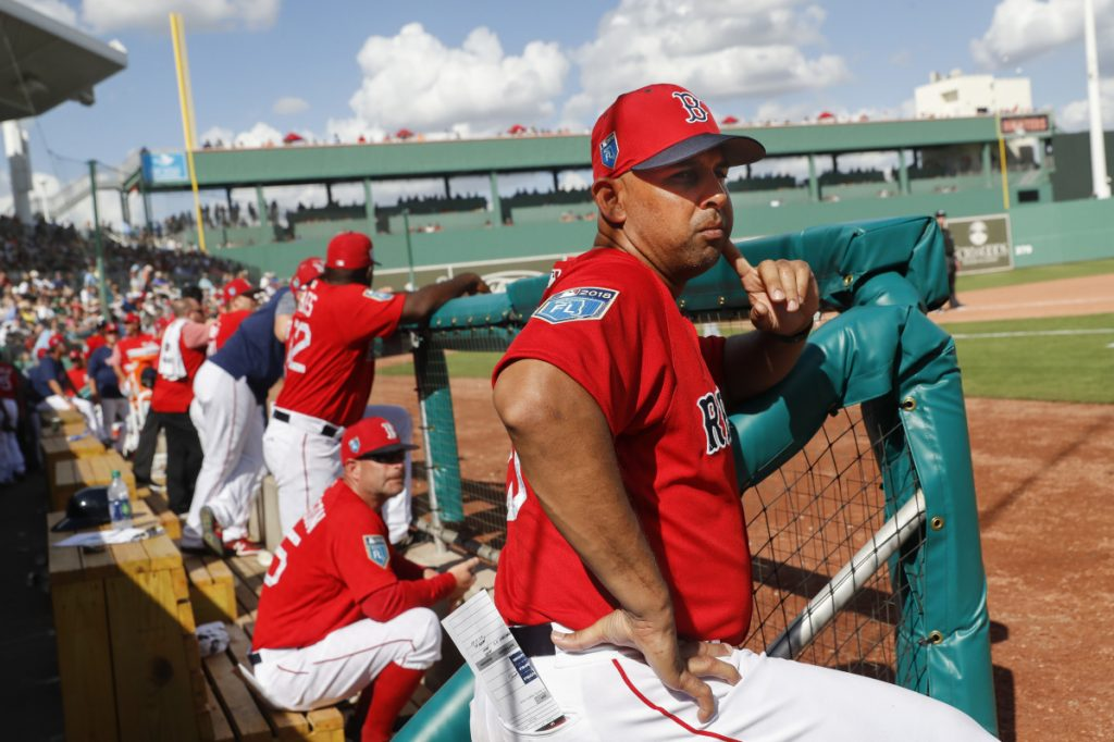 Boston Red Sox manager Alex Cora has proven deft so far in his handling of the team on and off the field. The Red Sox enter Tuesday's game at Tampa Bay with the most wins in baseball. (AP Photo/John Minchillo)
