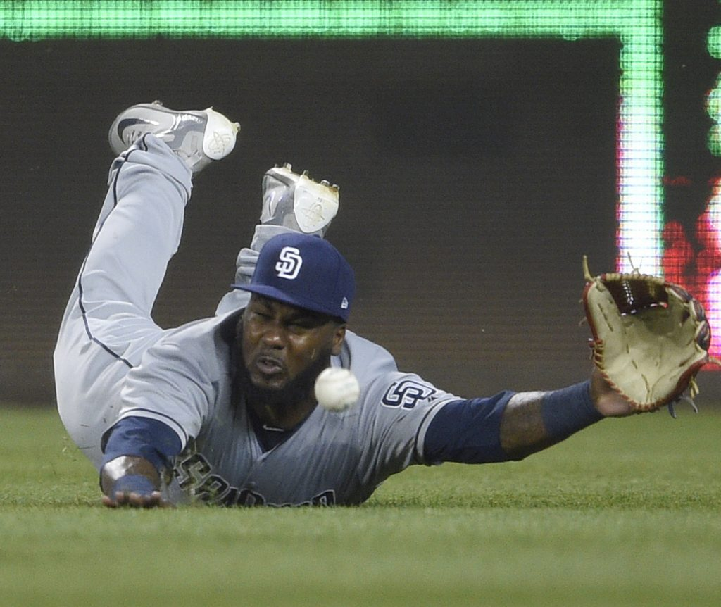 Right fielder Franmil Reyes of the San Diego Padres dives for a ball hit by Michael Taylor of Washington that went for a triple in the sixth inning Monday night. The Nationals came away with a 10-2 victory.