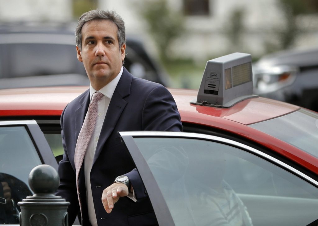 Michael Cohen, President Trump's personal attorney, steps out of a cab on Capitol Hill in September. When he went to work for the Trump Organization as a lawyer and executive vice president in 2006, he handed off the management of his taxi medallions first to Simon Garber and later to Evgeny Freidman.