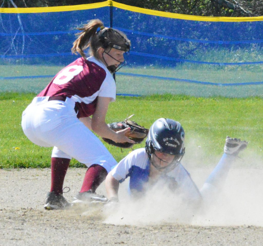 Sacopee Valley baserunner Lakyn Hink dives into second base ahead of a tag from Richmond shortstop Caitlin Kendrick, left, on Monday. Hink later scored the game's first run in Sacopee's 2-0 victory. (Brunswick Times Record photo by Bob Conn)
