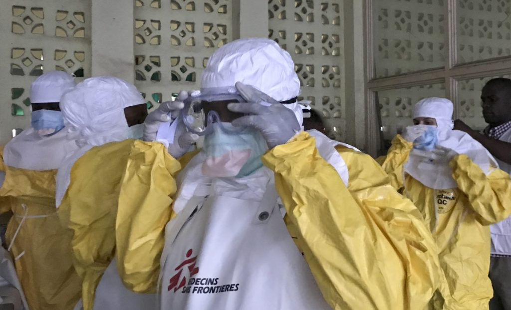 A team from Doctors Without Borders)dons protective clothing Sunday as they prepare to treat Ebola patients.