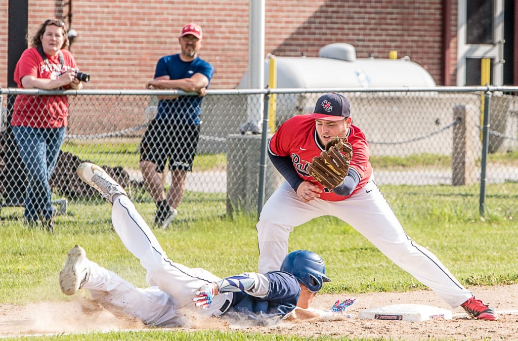 Tim MacDonald of York dives back to third base as Gray-New Gloucester's William Shufelt prepares to apply the tag Wednesday during York's 11-1 win.
