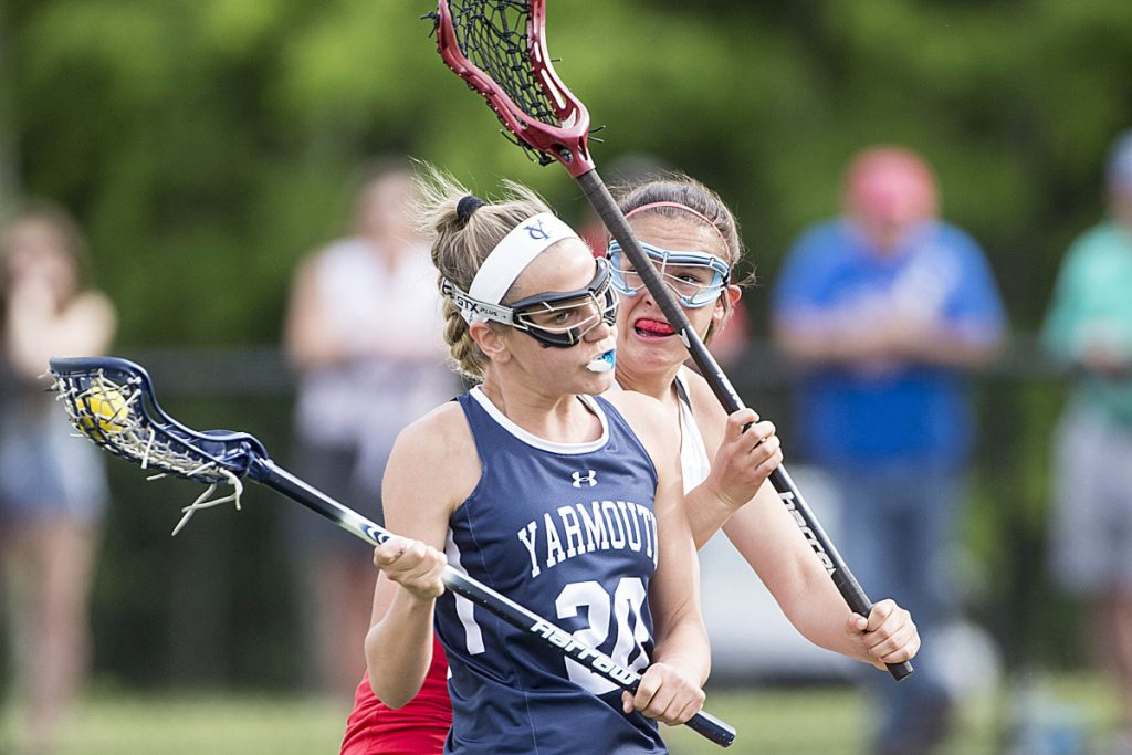 Yarmouth's Greta Elder tries to evade Messalonskee defender Gabby Smart during a Class B lacrosse game Friday afternoon at Thomas College in Waterville. Yarmouth won, 18-7.