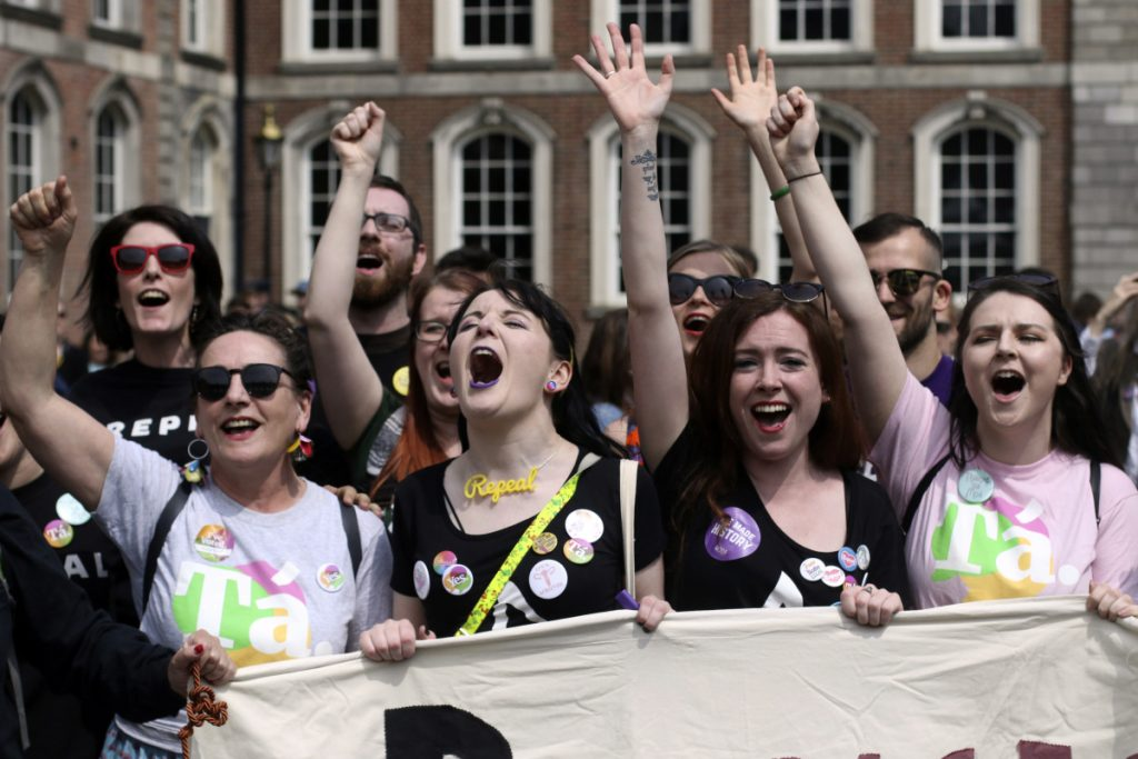 People from the yes campaign react at Dublin Castle in Dublin, Ireland, on Saturday as the results of the votes begin to come in.