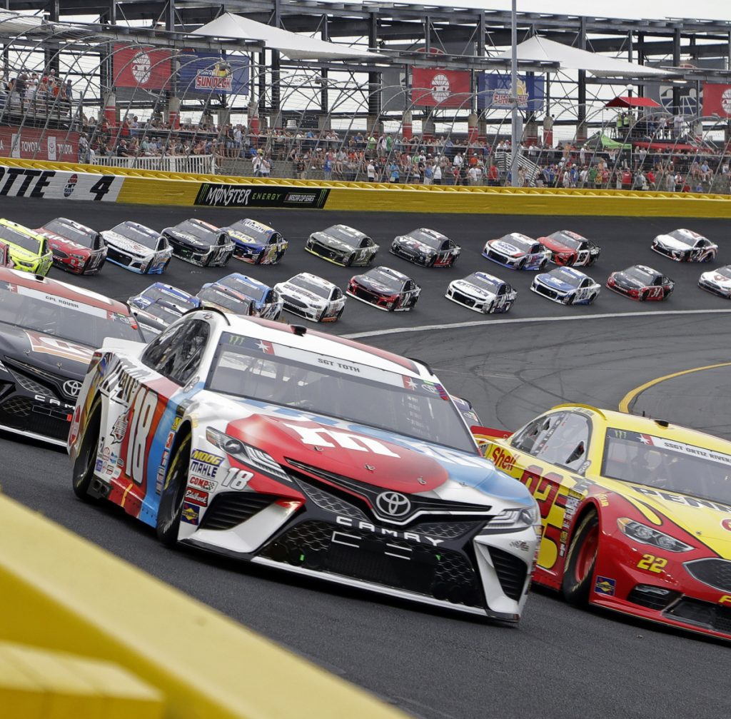 Kyle Busch, front left, leads the field Sunday night at the start of the Coca-Cola 600 at Charlotte Motor Speedway. Busch led most of the race and was in front at the end of all four stages.