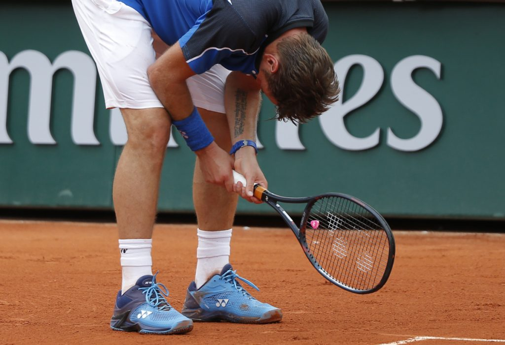 Former champ Wawrinka out of French Open; Djokovic advances