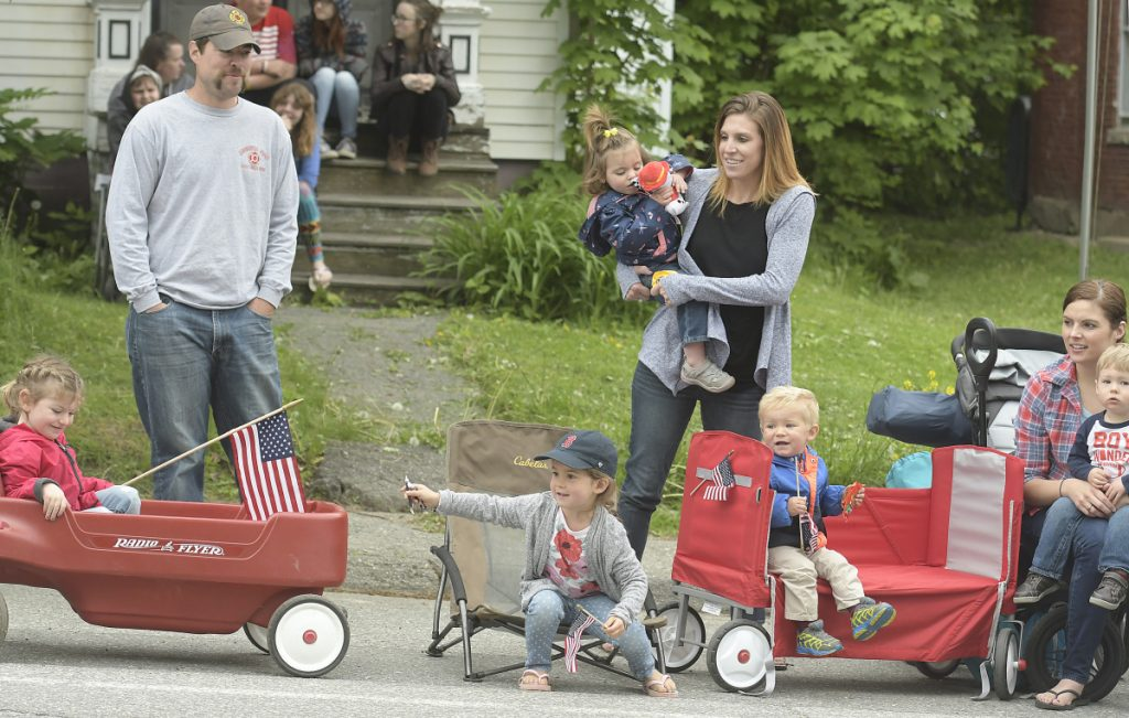 Children and their parents scramble for candy tossed into the crowd Monday during the Memorial Day parade through Gardiner.