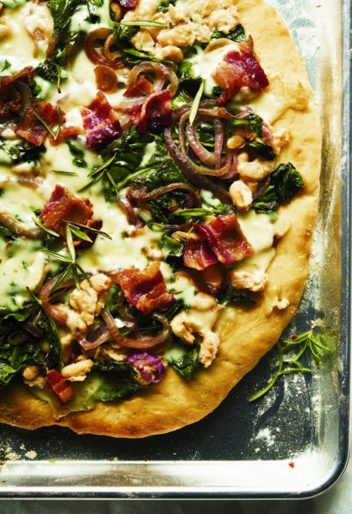 White Bean, Spinach and Bacon Pizza is a mostly healthy and entirely delicious choice, helped by plenty of garlic and fresh rosemary.