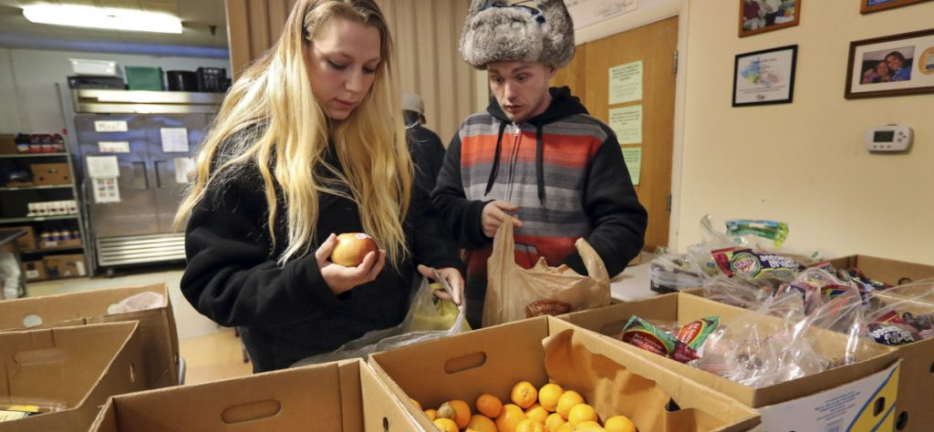 At an average of $4 a day, the federal benefits that help thousands of Mainers buy food don't last the entire month, forcing them to turn to the Augusta Food Bank, above in 2017, and other private sources of aid.
