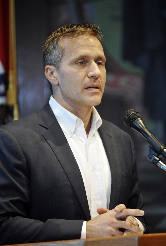 Missouri Gov. Eric Greitens reads from a prepared statement as he announces his resignation during a news conference on Tuesday.