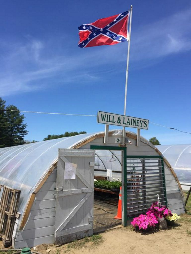 A Confederate battle flag flies over Will-N-Laineys farm stand in New Gloucester. A letter writer says he doesn't understand why any citizen would display it.