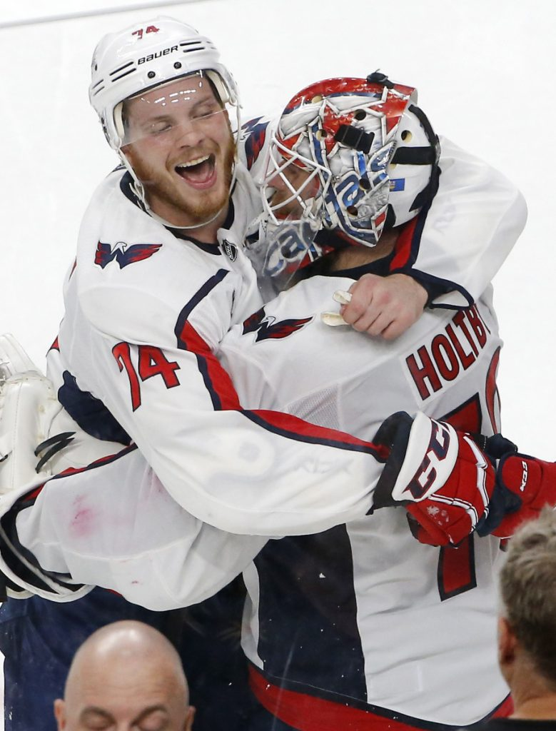Capitals defenseman John Carlson, left, and goaltender Braden Holtby celebrate after Washington's 3-2 win over Vegas in Game 2 Wednesday.