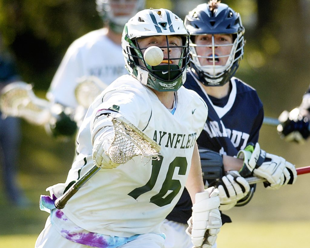 Waynflete's Hank Duvall reaches for a loose ball against Yarmouth during a 12-11 overtme victory for his Flyers on Thursday in Portland. Duvall scored four times for the Flyers.