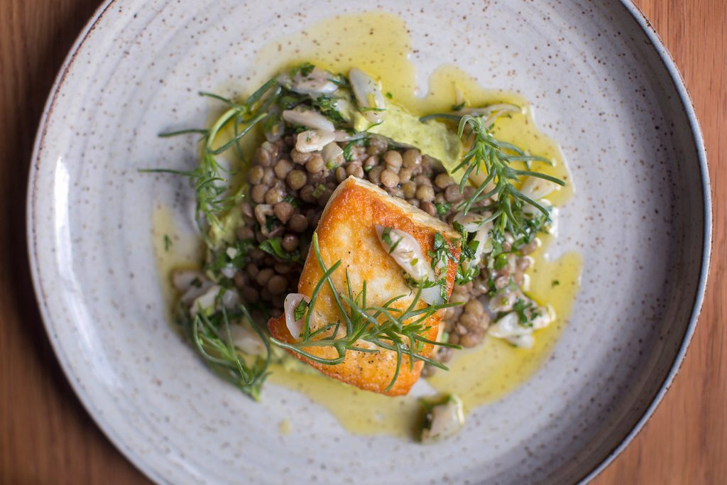 PORTLAND, ME - MAY 23: Halibut with lentils, razor clams, ramp mayo and agretti at Drifters Wife.  (Staff photo by Brianna Soukup/Staff Photographer)