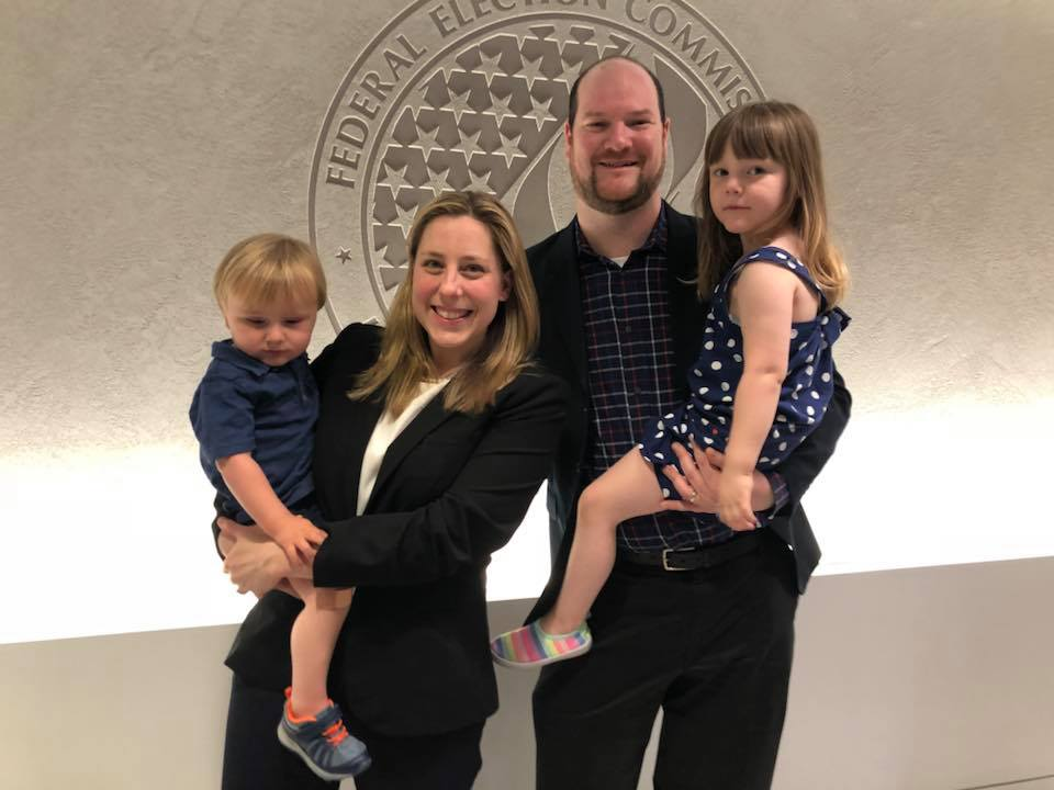 Liuba Grechen Shirley poses with her husband and two small children.