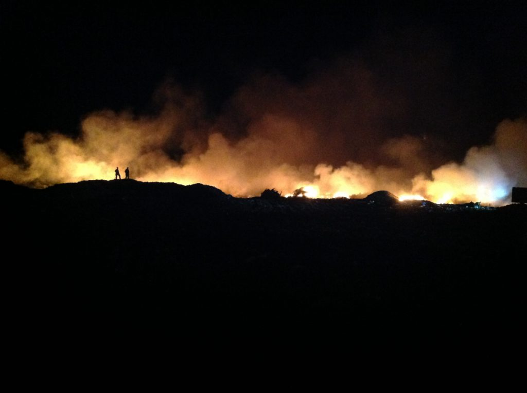 Firefighters from eight towns around the region responded to help the Augusta Fire Department knock down a large fire at the Hatch Hill landfill in east Augusta. The fire was first reported by a Life Flight helicopter crew member, who spotted the flames overnight. A fire ignited again early Sunday morning about 100 yards away from the Saturday blaze.