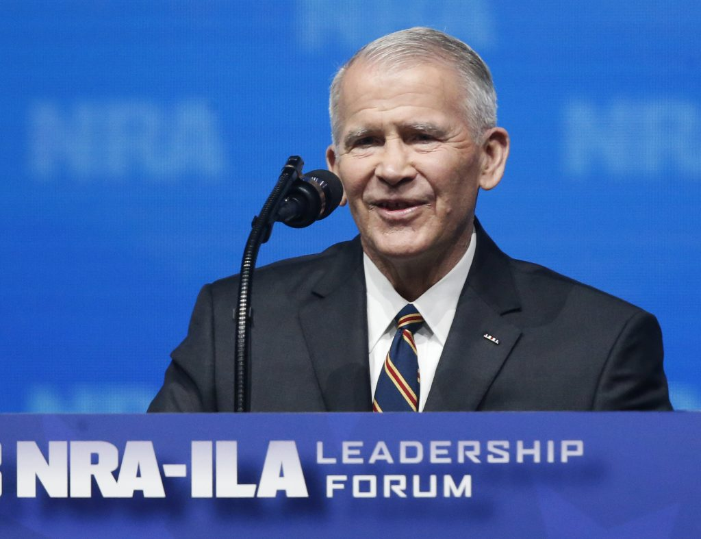 In this May 4, 2018 photo, former U.S. Marine Lt. Col. Oliver North speaks before giving the Invocation at the National Rifle Association-Institute for Legislative Action Leadership Forum in Dallas. The NRA announced today that North will become President of the National Rifle Association of America.