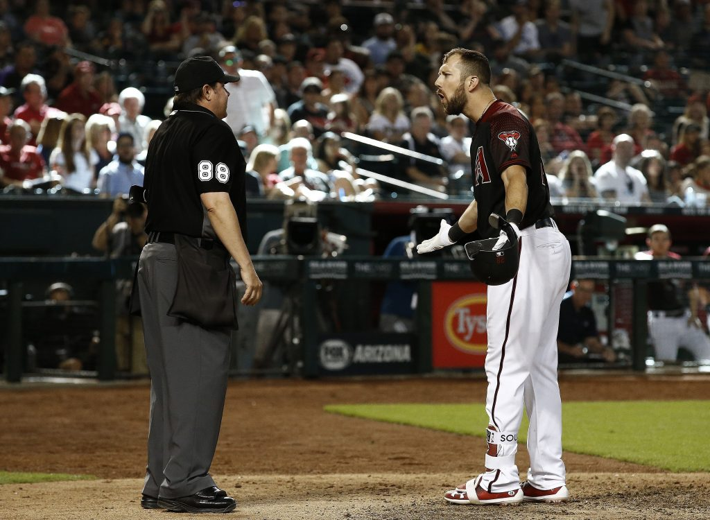 Arizona Diamondbacks' Steven Souza Jr., right, argues with umpire Doug Eddings after Souza was thrown out for throwing his bat after a third strike during the eighth inning of the team's baseball game against the Washington Nationals on Saturday in Phoenix. The Nationals won 2-1.