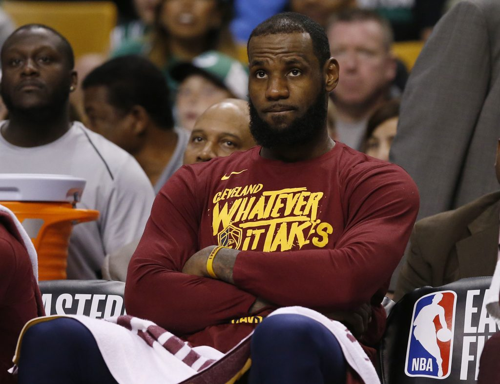 Cleveland Cavaliers forward LeBron James watches from the bench during the fourth quarter of Game 1 of the NBA basketball Eastern Conference Finals against the Boston Celtics on Sunday in Boston.