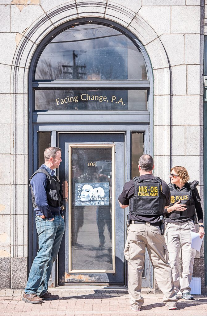 Federal agents assemble outside of the Facing Change office in Lewiston on Tuesday morning.