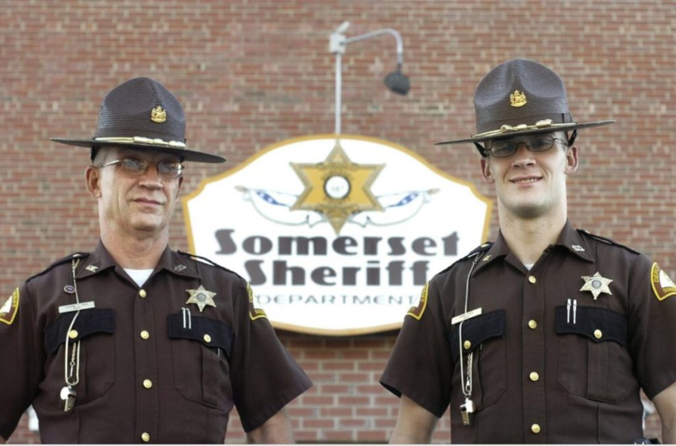 Somerset County Sheriff's Cpl. Eugene Cole, left, and his son, now Detective David Cole, pose in this undated photo.