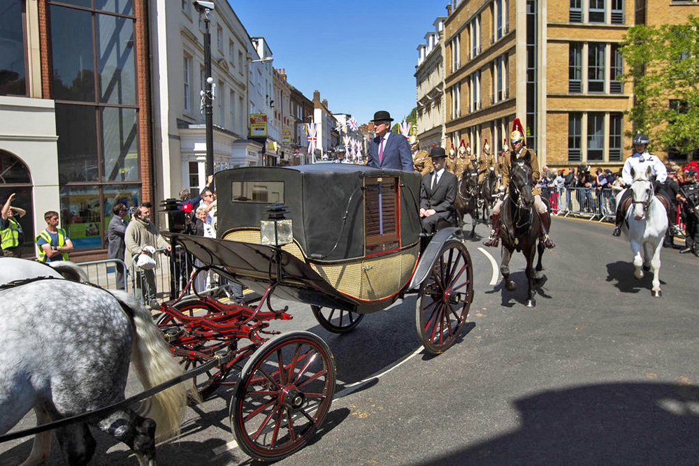 A royal carriage passes through the streets of Windsor, England, during a rehearsal Thursday for the wedding procession of the Prince Harry and Meghan Markle. The wedding is Saturday.