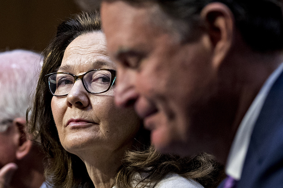Gina Haspel, nominee to lead the  CIA, listens while being introduced by former Sen. Evan Bayh, D-Ind., right, during the Senate Intelligence Committee confirmation hearing  Wednesday.