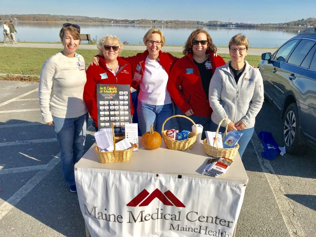 Maine Medical Center nurses, (from left) Emily Morris, R.N.; Lynne White, R.N.;  Leslie Knight, R.N.; Heidi Gwinn, R.N., and Rose Tanguay, R.N., strive to improve public health by volunteering at the 2017 National Prescription Drug Take Back Day at Back Cove in Portland.