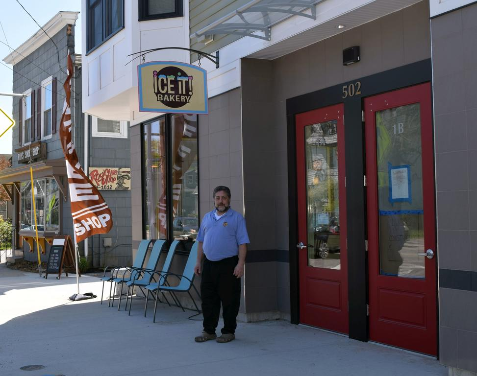 Ice It! co-owner Alan Fried stands outside the Deering Center bakery location in Portland in May.