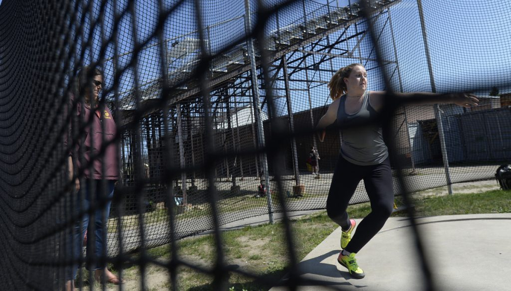 Johnna Scott of Thornton Academy, working under Coach Lisa Huntress, and her teammate Jaigan Boudreau are the two top discus throwers in the state.