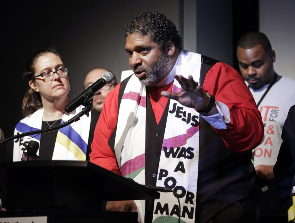 The Rev. Dr. William J. Barber II, center, and the Rev. Dr. Liz Theoharis, co-chairs of the Poor People's Campaign, speak April 3 at the National Civil Rights Museum. Spiritual leaders need to reach the public, a letter writer says.