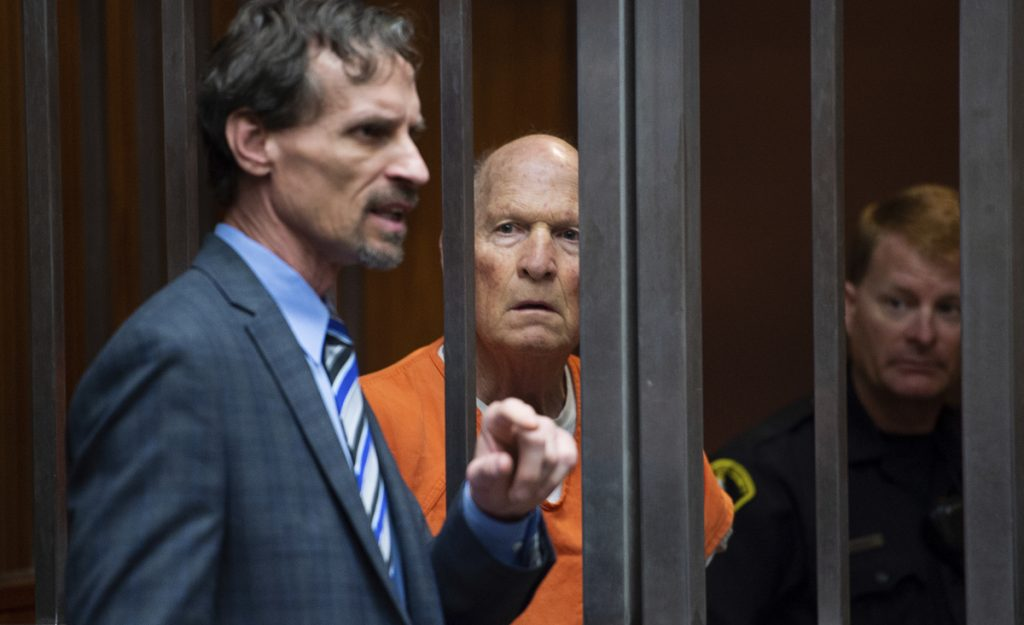 Joseph DeAngelo stands with his attorney Joe Cress in a Sacramento, Calif., jail court on May 29. DeAngelo, dubbed the Golden State Killer, has been charged with the murder of 12 people.