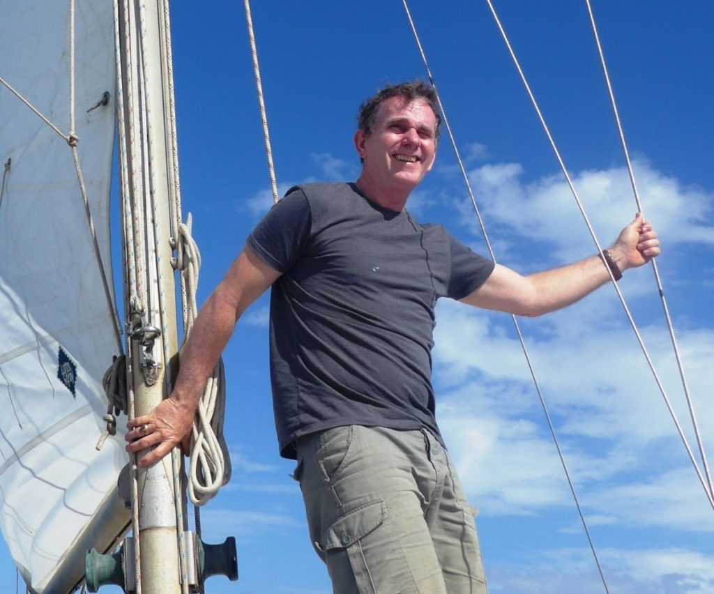 Michael Hurley was rescued from his storm-battered sailboat by the Maine Maritime Academy training ship in 2015. Hurley, a novelist, has completed a 7,000-mile sail that will be capped off with a wedding in London.
