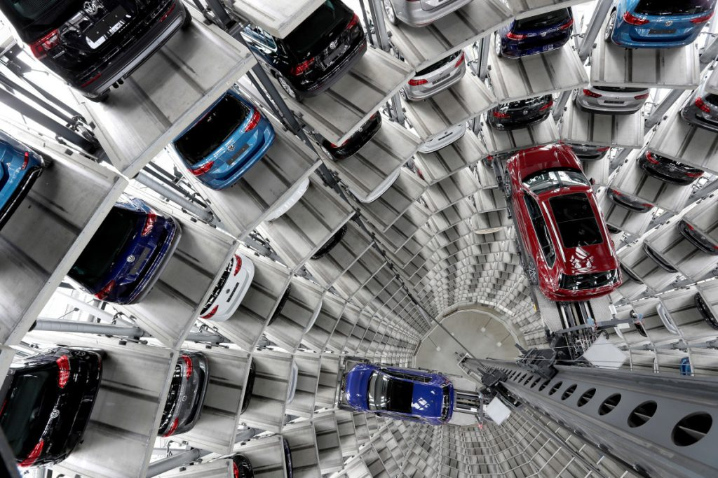 Volkswagen cars are lifted inside a delivery tower of the company in Wolfsburg, Germany. Germany's Volkswagen, Europe's largest automaker, is warning that the Trump administration's decision to impose tariffs on aluminum and steel imports from Canada, Mexico, and the European Union could start a trade war that no side would win.