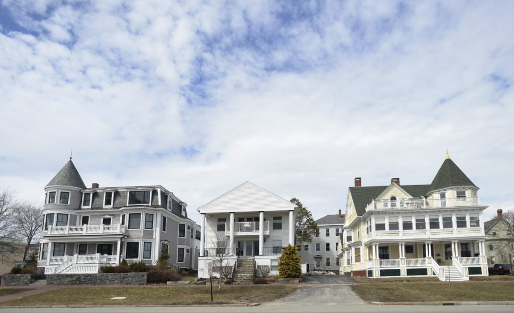 Large homes line the Eastern Promenade in Portland. The proposed Munjoy Hill Conservation Overlay District would make it more difficult to demolish some architecturally significant buildings. The City Council is expected to vote on the plan Monday.
