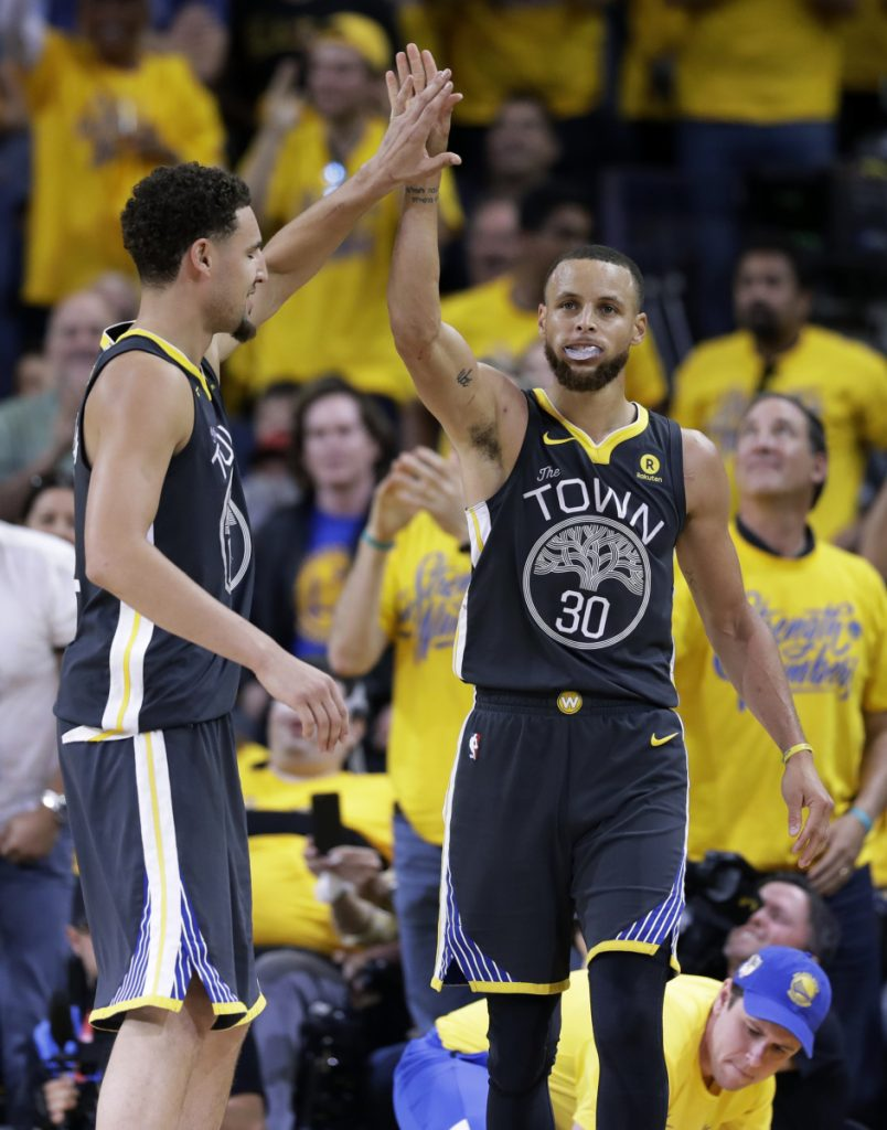Golden State Warriors guard Stephen Curry (30) celebrates with guard Klay Thompson (11) during the second half of Game 2 of basketball's NBA Finals in Oakland, Calif., Sunday, June 3, 2018. (AP Photo/Marcio Jose Sanchez)