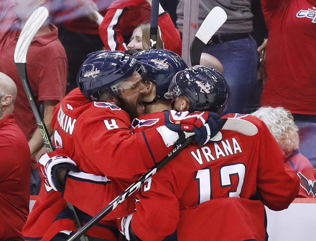 Washington Capitals forward Alex Ovechkin, left, and forward Jakub Vrana, right, celebrate one of their team's goals against the Vegas Golden Knights during the third period in Game 4 of the Stanley Cup final, Monday in Washington. The Capitals won 6-2 to take a 3-1 series lead.