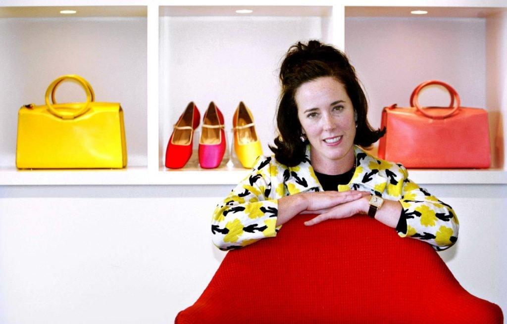 Kate Spade is shown in 2004 with handbags and shoes from her collection.